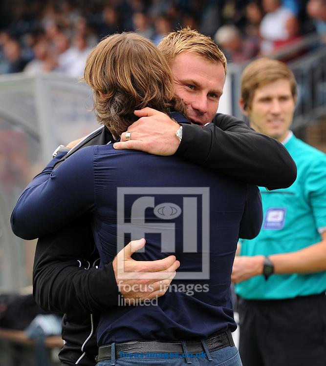 Gareth Ainsworth of Wycombe Wanderers and David Flitcroft of Bury embrace during the Sky Bet League 2 match at Adams Park, High Wycombe<br /> Picture by Seb Daly/Focus Images Ltd +447738 614630<br /> 06/09/2014