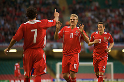 CARDIFF, WALES - Saturday, October 11, 2008: Wales' David Edwards celebrates scoring the opening goal against Liechtenstein with team-mates Simon Davies and Chris Gunter during the 2010 FIFA World Cup South Africa Qualifying Group 4 match at the Millennium Stadium. (Photo by David Rawcliffe/Propaganda)