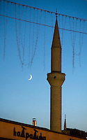 A mosque tower with the crescent moon in Cappadocia, Turkey