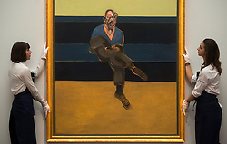 © Licensed to London News Pictures. 12/04/2013. London, UK. Gallery assistants mount Francis Bacon's 'Study for a Portrait of P. L.' painting with an estimated value of between 30 - 40 million USD for the upcoming New York auctions. Highlights from Sotheby's New York auctions of Impressionist and Modern Art and Contemporary Art will be exhibited to the public from 12-16 April at  Sotheby's London New Bond Street galleries. Photo credit : Peter Kollanyi/LNP