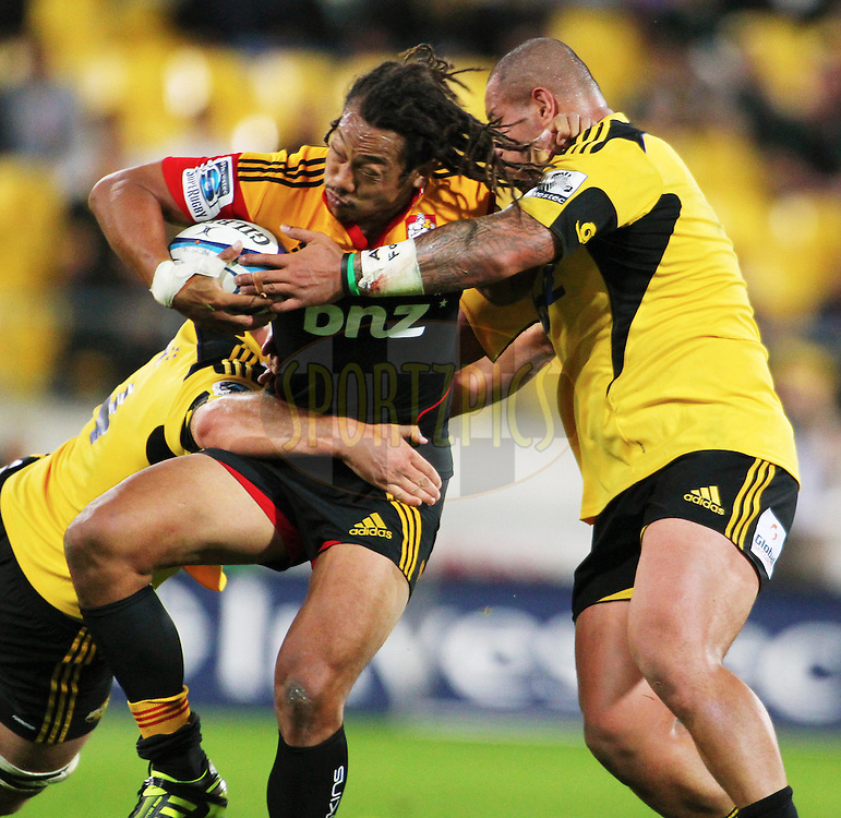 Tana Umaga on attack for Chiefs during the Investec Super 15 rugby match - Hurricanes v Chiefs at Westpac Stadium, Wellington, New Zealand on Saturday, 12 March 2011. Photo: Justin Arthur / photosport.co.nz