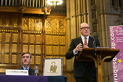 © Licensed to London News Pictures . 02/10/2017. Manchester, UK. JACOB REES-MOGG with a framed portrait of Margaret Thatcher , listening to GERARD LYONS speak , at a fringe , right-wing Bruges Group event at Manchester Town Hall , surrounded by media , during the second day of the Conservative Party Conference at the Manchester Central Convention Centre . Photo credit: Joel Goodman/LNP
