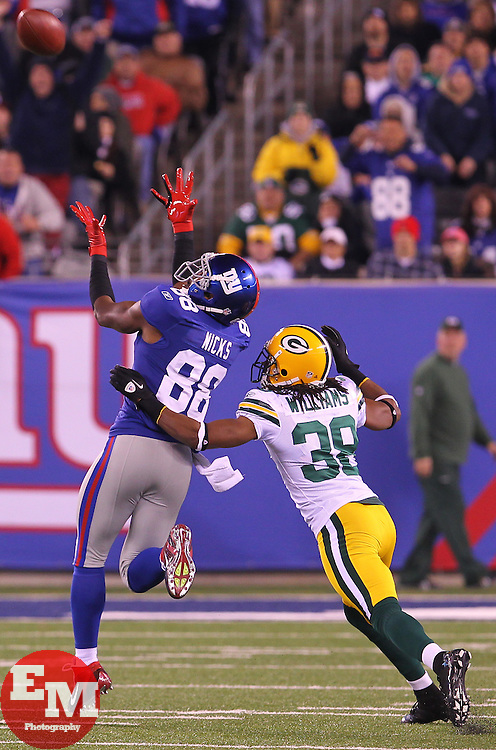 Dec 4, 2011; East Rutherford, NJ, USA; New York Giants wide receiver Hakeem Nicks (88) catches a pass from New York Giants quarterback Eli Manning (10) while being defended by Green Bay Packers cornerback Tramon Williams (38) during the second half at MetLife Stadium. The Packers defeated the Giants 38-35.