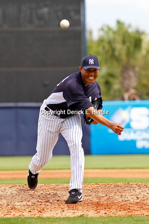 March 11, 2012; Tampa Bay, FL, USA; New York Yankees relief pitcher Mariano Rivera (42) throws during the top of the fourth inning of a spring training game against the Philadelphia Phillies at George M. Steinbrenner Field. Mandatory Credit: Derick E. Hingle-US PRESSWIRE