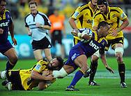 Hurricanes lock Jason Eaton tackles Alando Soakai. Super 15 rugby match - Hurricanes v Highlanders at Westpac Stadium, Wellington, New Zealand on Friday, 18 February 2011. Photo: Dave Lintott/PHOTOSPORT/SPORTZPICS