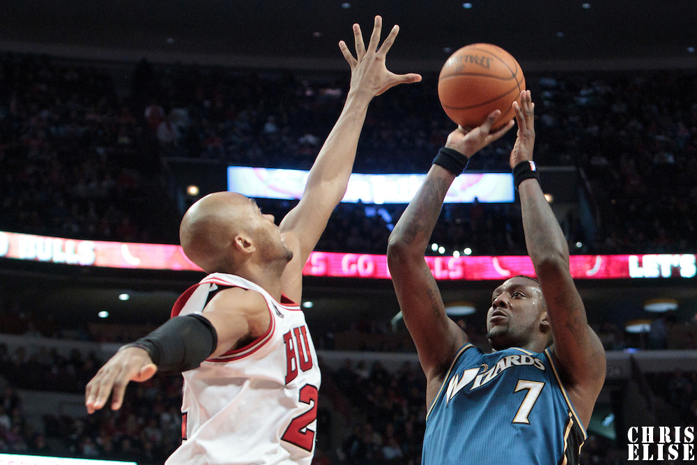 13 November 2010: Washington Wizards' power forward #7 Andray Blatche over Chicago Bulls' forward #22 Taj Gibson during the Chicago Bulls 103-96 victory over the Washington Wizards at the United Center, in Chicago, Illinois, USA.