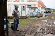 Johnny Heflin looks out at his ranch after a meeting with the EPA, Army and local residents to discuss the disposal of 15 million pounds of M6 located at Camp Minden in Doyline, Louisiana on March 11, 2015. Heflin lives less than two miles from Camp Minden and is afraid some disposal methods will pollute the air and water that could lead to complications for his family and livestock. (Cooper Neill for The New York Times)