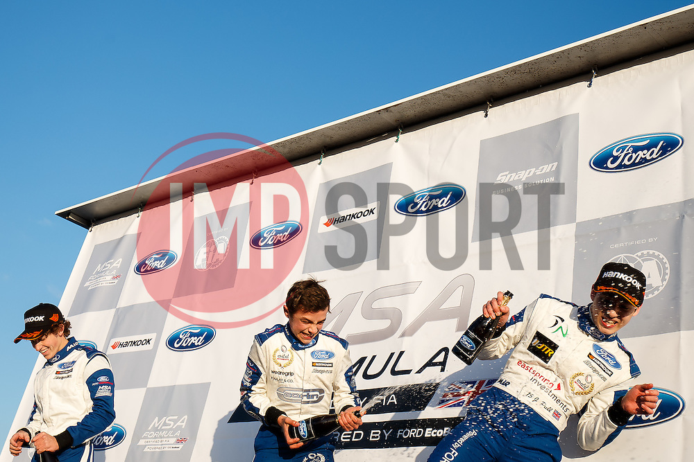 Lando Norris (centre) celebrates his second win of the weekend | #31 Carlin | MSA Formula Championship | Race 2 - Photo mandatory by-line: Rogan Thomson/JMP - 07966 386802 - 04/04/2015 - SPORT - MOTORSPORT - Fawkham, England - Brands Hatch Circuit - British Touring Car Championship Meeting Day 2.