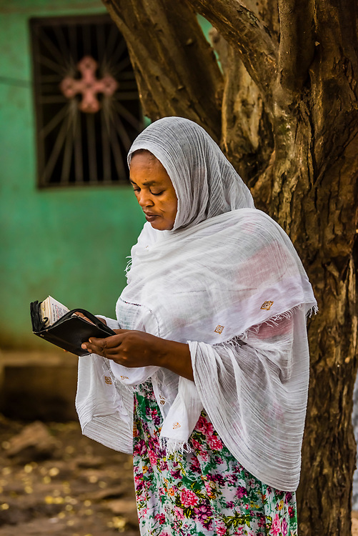Ethiopian women praying at St. Gebriel Orthodox Church  (Ethiopian Orthodox Church) during Meskel celebration, Arba Minch, Ethiopia.                                              Meskel commemorates the discovery of the True Cross by the Roman Empress Helena in the fourth century.