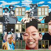 Colourful mural of smiling faces in San Francisco Chinatown