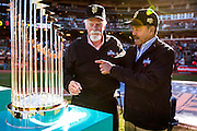 SAN FRANCISCO, CA - APRIL 18: Baseball Hall of Famers, Gaylord Perry and Juan Marichal, admire the 2014 World Series trophy on the field during the Giants World Series ring ceremony at AT&T Park on Saturday, April 18 2015 in San Francisco, California. Photo by Jean Fruth