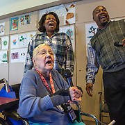 MANASSAS, VA - NOV21:  Norma Felter does karaoke with Thelma Wallace (left), a quality care aid, and Carl Powell, Director of Therapeutic Recreation, at Birmingham Green, an elder care residence in Manassas, VA, November 21, 2014. With the U.S. population aging and Alzheimer's more widespread, science is looking for ways to slow or delay the onset of dementia in aging Americans. Among the approaches is trying to determine whether art, music and dance or movement can also alleviate the problems attendant with dementia. The federal government is funding a study at Birmingham Green with George Mason University to see whether there is a scientific basis to believe that art is actually medically beneficial. (Photo by Evelyn Hockstein/For The Washington Post)