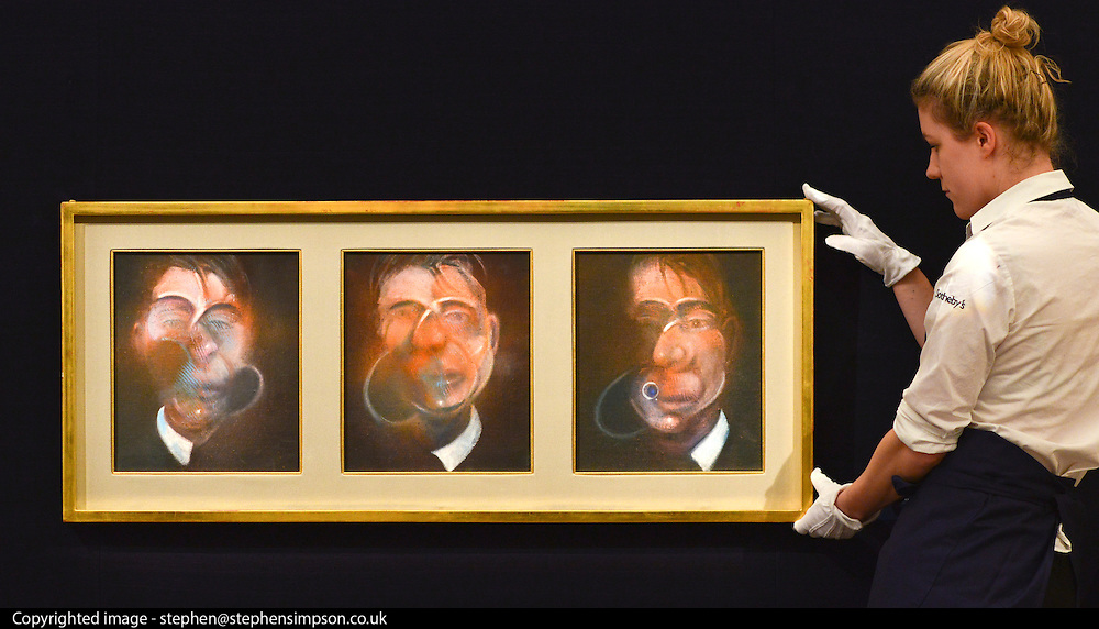 © Licensed to London News Pictures. 31/01/2013. London, UK An employee holds Francis Bacon's .Three Studies for a Self-Portrait estimated to raise 10,000,000 - 15,000,000 GBP. Preview of highlights from Sotheby's forthcoming February sales of Impressionist & Modern Art and Contemporary Art in London, including works by Picasso, Bacon, Monet, Richter and Miró. Photo credit : Stephen Simpson/LNP