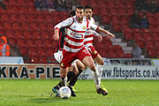 Doncaster Rovers midfielder Matty Blair (17) in possession during the EFL Sky Bet League 1 match between Doncaster Rovers and Blackburn Rovers at the Keepmoat Stadium, Doncaster, England on 24 April 2018. Picture by Mick Atkins.