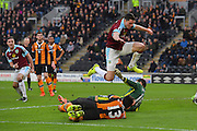 Burnley FC defender Michael Keane (5)  jumps over Hull City player Andrea Ranocchia (13) and Hull City goalkeeper Eldin Jakupovic (16) after scoring goal to go 1-1 during the Premier League match between Hull City and Burnley at the KCOM Stadium, Kingston upon Hull, England on 25 February 2017. Photo by Ian Lyall.