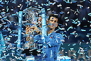 Novak Djokovic lifts the wining trophy during the final of the ATP World Tour Finals between Roger Federer of Switzerland and Novak Djokovic at the O2 Arena, London, United Kingdom on 22 November 2015. Photo by Phil Duncan.
