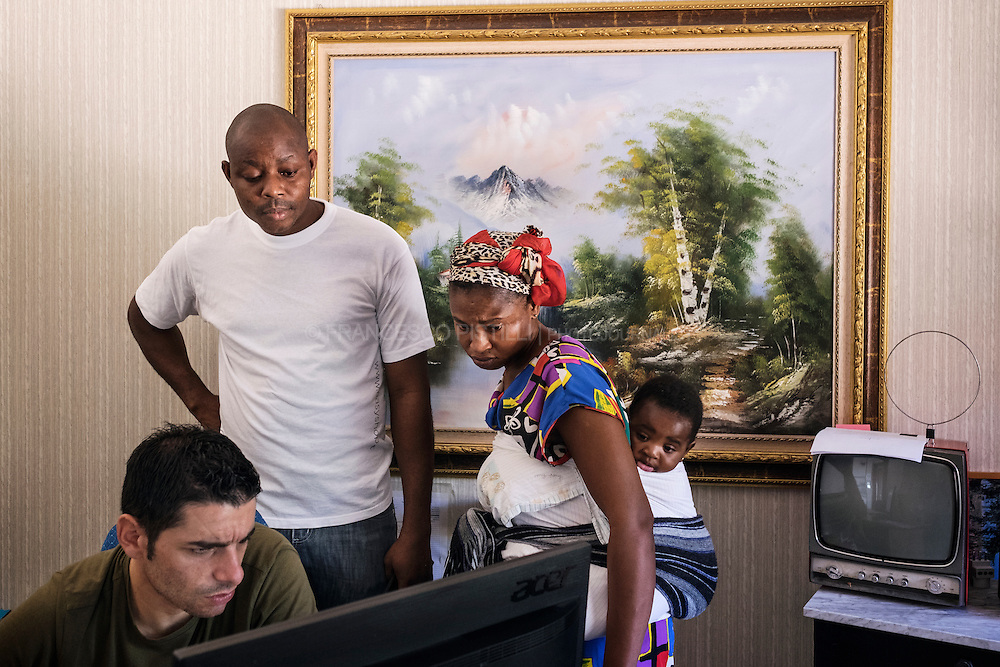 In this picture Luca a Protezione Civile worker is trying to get more infos about some documents   for  Osayomore 33 years old from Nigeria and his wife Nicole 26 years old from Ivory Coast, both arrived in October 2015 in Italy. Nicole did her dangerous travel from Libya alone while she was pregnant, she was rescued in the Mediterranean by Italian Coast Guard and landed in Palermo. Grace their little daughter was born 9 days after in Palermo. &quot;We were waiting on a libyan beach when a rebel group attacked the migrants, women and children were already on board and during the heavy shooting they set sailing&quot; says Osayomore <br /> &quot;all the men escaping on the shore, far from the bullets, someone died, I got the chance to find a safe place to wait the next boat to Sicily just few days later. It was so terrible, a lot of bullets flying, hundreds of african guys terrified, wounded or died. I never seen something like this in my life. I was worried for my wife, she was alone on board after this shock, she didn&rsquo;t know about me for days, it was a nightmare that we want to forget here, in this peaceful village of southern Italy. We were lucky to arrive in this Sprar project, they are helping us a lot, like Luca is doing in this moment. We are still struggling to get a job but we love our safety here, we have a home for Grace here now. &rdquo;  RIACE (ITALY) 02/08/16