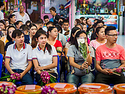 """30 DECEMBER 2017 - BANG KRUAI, NONTHABURI, THAILAND:  People pray to make merit for the new year at Wat Ta Khien, about 45 minutes from Bangkok in Nonthaburi province. The temple is famous for the """"floating market"""" on the canal that runs past the temple and for the """"resurrection ceremonies"""" conducted by monks at the temple.      PHOTO BY JACK KURTZ"""