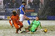 Luton Town forward Kazenga LuaLua (25) goes towards goal and is challenged by Portsmouth goalkeeper Craig MacGillivray (15) during the EFL Sky Bet League 1 match between Luton Town and Portsmouth at Kenilworth Road, Luton, England on 29 January 2019.