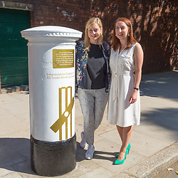 ECB Head of Communications Claire Jackson, left and Head of Marketing Jenny Smith pose with a white-painted postbox outside Lords Cricket Ground with a plaque and graphics that celebrate England's ICC Cricket World Cup Victory. London, July 16 2019.