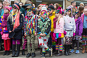 UNITED KINGDOM, Whittlesey: Straw Bear Festival. Children from Alderman Jacobs Primary School wait to perform during the Straw Bear festival this weekend. The colourful three day festival, which originated in 1882, consists of traditional Molly, Morris, Clog and Sword dancing as well as parading a large straw character known as 'The Bear' through the town. Rick Findler  / Story Picture Agency