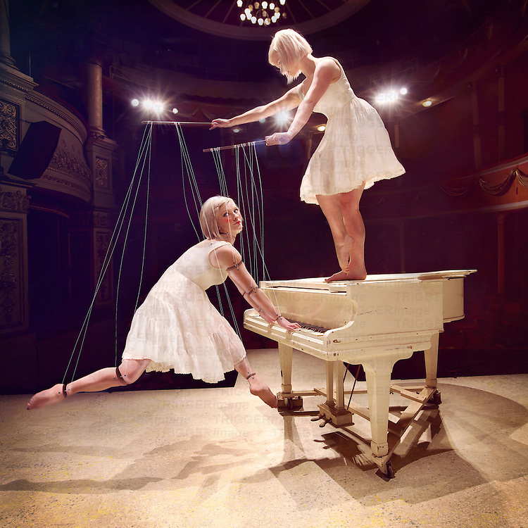 Conceptual image of young blonde females on piano