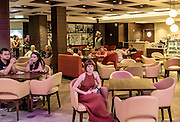 Royal Caribbean, Harmony of the Seas, woman in a cafe at the Royal Promenade