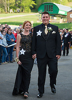 Natalie Compton and Brycen Martin march through the crowds gathered for Laconia High School's Junior Prom at Gunstock Friday evening.  (Karen Bobotas/for the Laconia Daily Sun)