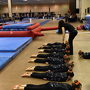 Gymnasts warm up before competition during the 21st American Invitational 2014 competition at the XL Centre. Hartford, Connecticut, USA. USA. 31st January 2014. Photo Tim Clayton