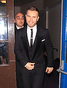 05.NOVEMBER.2012. LONDON<br /> <br /> GARY BARLOW LEAVING THE MUSIC INDUSTRY TRUSTS AWARD CEREMONY AT THE GROSVENOR HOUSE HOTEL IN MAYFAIR.<br /> <br /> BYLINE: EDBIMAGEARCHIVE.CO.UK<br /> <br /> *THIS IMAGE IS STRICTLY FOR UK NEWSPAPERS AND MAGAZINES ONLY*<br /> *FOR WORLD WIDE SALES AND WEB USE PLEASE CONTACT EDBIMAGEARCHIVE - 0208 954 5968*
