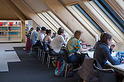 Students study inside the Hive, Worcester is the first fully integrated university and public library in the UK.