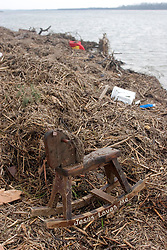 25 Sept, 2005.  Cameron, Louisiana.  Hurricane Rita aftermath. <br /> A childs' hobby horse lies washed up with the words 'Jesus loves me' written on the runners. <br /> Photo; &copy;Charlie Varley/varleypix.com