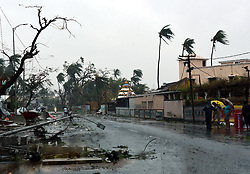 May 3, 2019 - Odisha, India - Uprooted trees and other things lie as others stand amid gusty winds in Puri district after Cyclone Fani hit the coastal eastern state of Odisha, India. Three people died in India's eastern state of Odisha as the extremely severe cyclone Fani hit the state on Friday morning and continued till beyond noon. A large number of trees and electricity poles were uprooted, and power supply was cut off in many parts of the state. Many areas in Puri of Odisha and other places were submerged as heavy rain battered the coast. (Credit Image: © Stringer/Xinhua via ZUMA Wire)