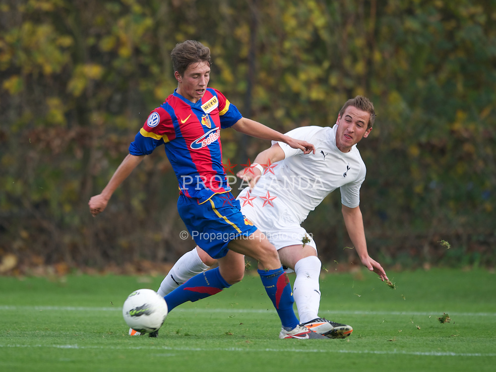 LONDON, ENGLAND - Wednesday, November 23, 2011: Tottenham Hotspur's Harry Kane in action against FC Basel 1893's Robin Vecchi during the NextGen Series Group 4 match at the Spurs Lodge. (Pic by David Rawcliffe/Propaganda)