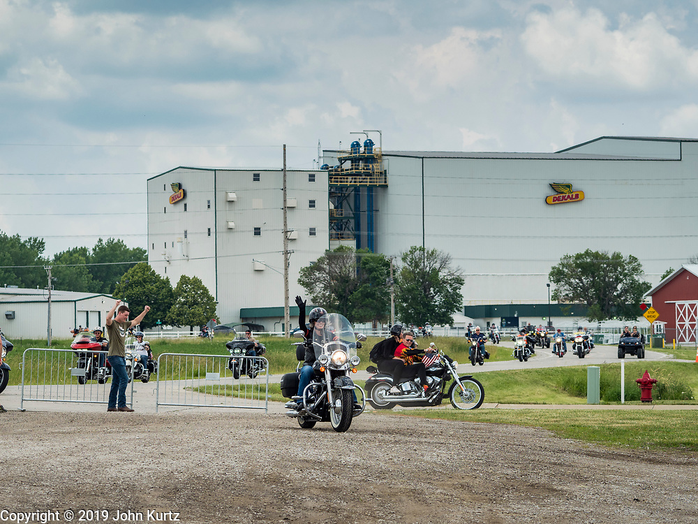 "15 JUNE 2019 - BOONE, IOWA: US Senator JONI ERNST (center) waves as she arrives at ""Joni's Roast and Ride"", a motorcycle ride / barbecue fund raiser she hosts. Ernst, Iowa's junior US Senator, kicked off her re-election campaign during the ""Roast and Ride"", an annual fund raiser and campaign event she has held since originally being elected to the US Senate in 2014.     PHOTO BY JACK KURTZ"