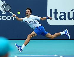 March 24, 2019 - Miami, FL, USA - Novak Djokovic returns a ball to Fererico Delbonis on Sunday, March, 24, 2019 at the Miami Open in Miami Gardens, Fla. (Credit Image: © Charles Trainor Jr/Miami Herald/TNS via ZUMA Wire)