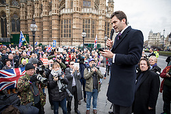 © Licensed to London News Pictures. 23/11/2016. London, UK. UKIP leadership candidate John Rees Evans campaigns with demonstrators outside the Houses of Parliament for a 'hard Brexit' on the day Chancellor of the Exchequer Philip Hammond releases the autumn statement. Photo credit : Tom Nicholson/LNP