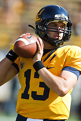 October 9, 2010; Berkeley, CA, USA;  California Golden Bears quarterback Kevin Riley (13) warms up before the game against the UCLA Bruins at Memorial Stadium.