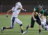 Kennedy's Alexander Hillyer (28) eyes Jefferson's Anthony Shumacher (2) on a run during first quarter of the game between Cedar Rapids Jefferson and Cedar Rapids Kennedy at Kingston Stadium in Cedar Rapids on Friday September 28, 2012. It was 24-0 Kennedy at halftime.