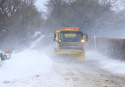 © Licensed to London News Pictures. 12/03/2013, Cuckfield, UK.  A snow plough clears a road near Cuckfield, West Sussex, England, as roads are affected by heavy snow fall, Tuesday, March 12, 2013. Photo credit : Sang Tan/LNP