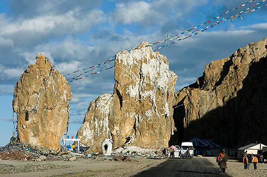 Prayer flags stung along rocks near Lake Namtso. Altitudes above 17,000 feet. Tibet. Asia.