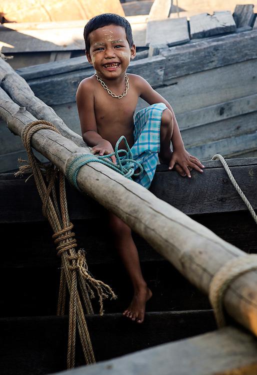 A boy on a boat near Yangon, Myanmar.