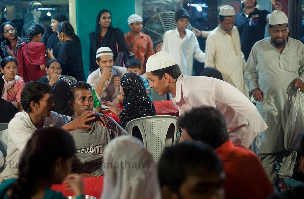 Abdullah Nasir serves customers and runs the stall at the largets food stall, opposite Minara masjid at Mohammed Ali road in Mumbai, Maharashtra, India, on Saturday September 6, 2009. Photographer: Prashanth Vishwanathan/The National