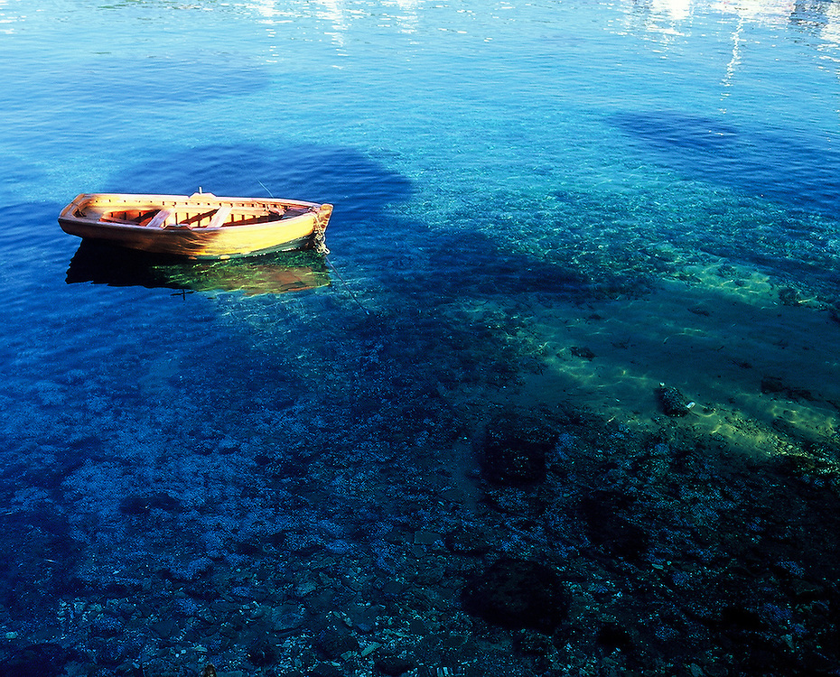 Small boat moored off coast of Skiathos, Greece