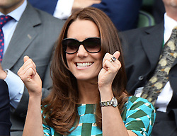 Image licensed to i-Images Picture Agency. 06/07/2014. London, United Kingdom.  Duchess of Cambridge celebrates first set win by Federer at the Wimbledon Men's Final.  Picture by Andrew Parsons / i-Images