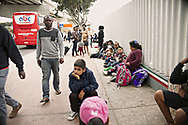 Undocumented migrants wait for asylum hearings outside of the port of entry in Tijuana, Mexico on Tuesday, June 19, 2018. (Photo by Sandy Huffaker for The New York Times)