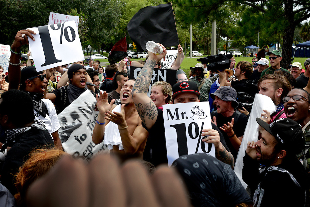 Protestors from the Black Bloc chant and dance as they prepared to march toward the 2012 Republican National Convention in Tampa, Fla. on Aug. 27, 2012.