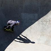 A skateboarder inside the bowl at Grayson Skatepark in East Charlotte.