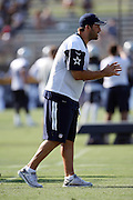 Dallas Cowboys quarterback Tony Romo (9) waits for the snap in a shotgun formation during the second day of the Dallas Cowboys 2016 NFL training camp football practice held on Sunday, July 31, 2016 in Oxnard, Calif. (©Paul Anthony Spinelli)