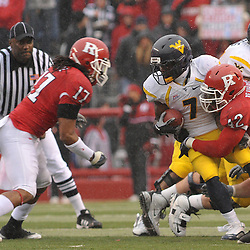 Dec 5, 2009; Piscataway, NJ, USA; Rutgers linebacker Steve Beauharnais (42) tackles West Virginia running back Noel Devine (7) during first half NCAA Big East college football action between Rutgers and West Virginia at Rutgers Stadium.